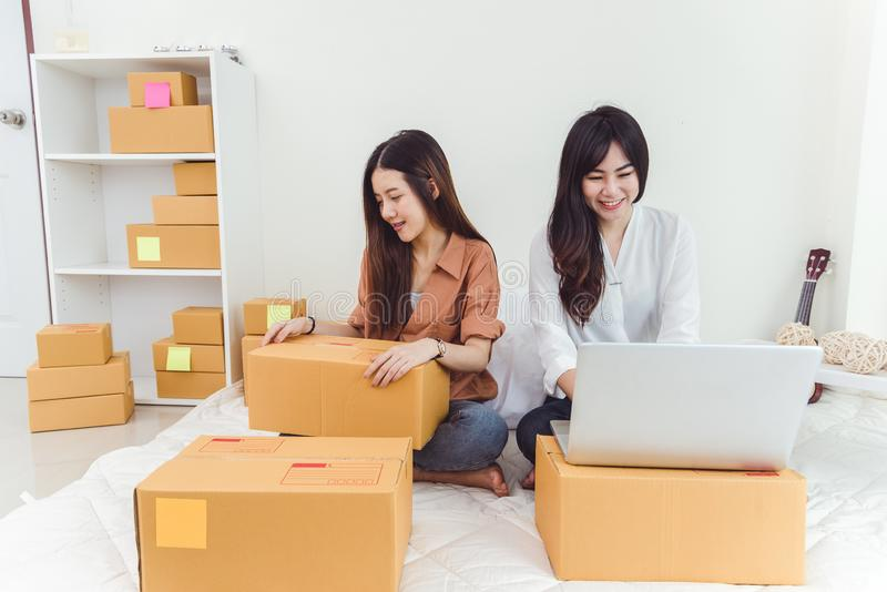 Young Asian woman startup small business entrepreneur SME distribution warehouse with parcel mail box. Owner home office concept. stock photos