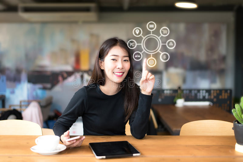 Young asian women using laptop payments online shopping and icon customer network connection on screen. Young asian woman using laptop payments online shopping stock photo
