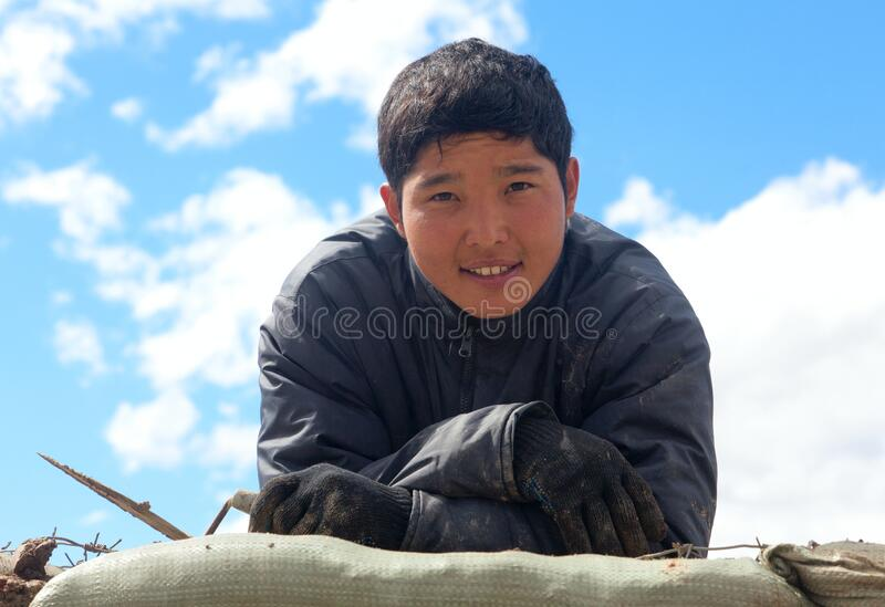 Young Asian worker. At a construction site royalty free stock photography