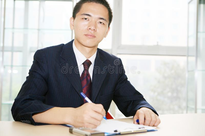 Download Young Asian Working In Office Stock Photo - Image of businessman, office: 6844426