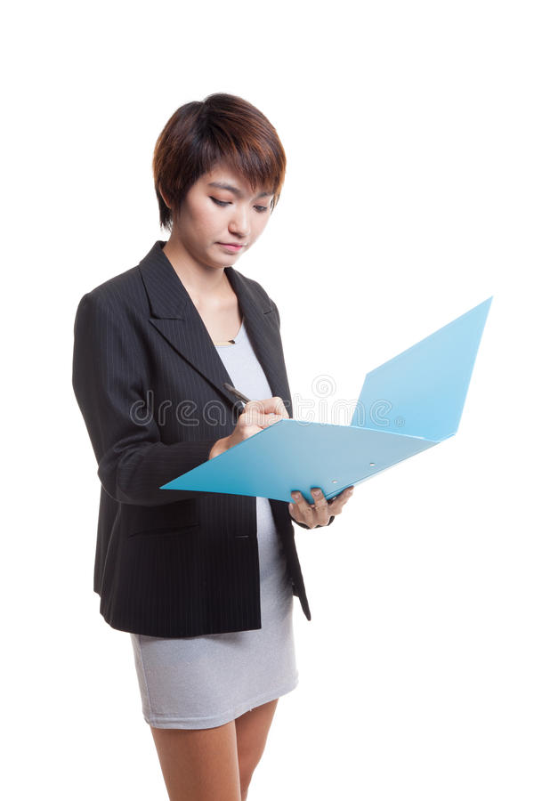 Young Asian working woman with folder. Young Asian working woman with folder isolated on white background stock photos
