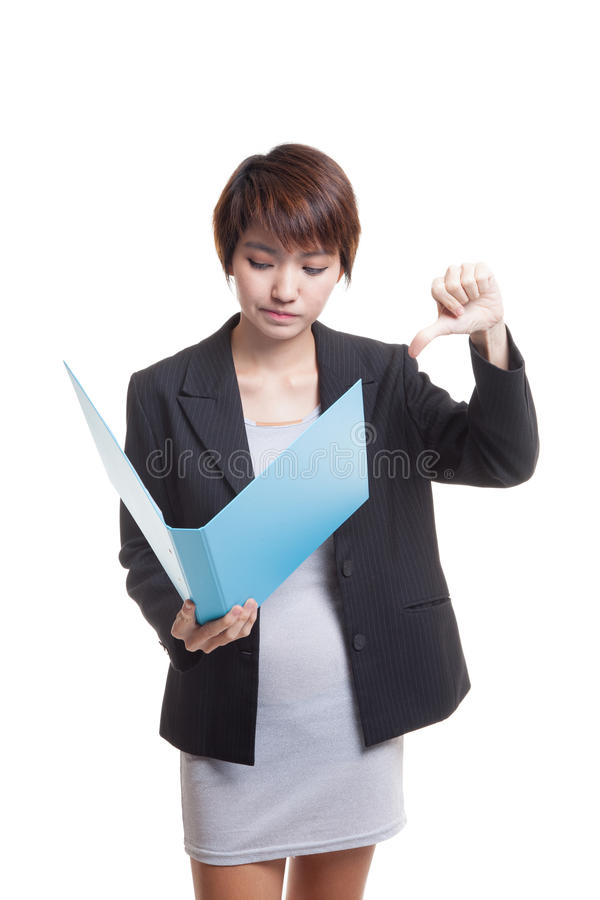 Young Asian working woman thumbs down with folder. Young Asian working woman thumbs down with folder isolated on white background royalty free stock photography