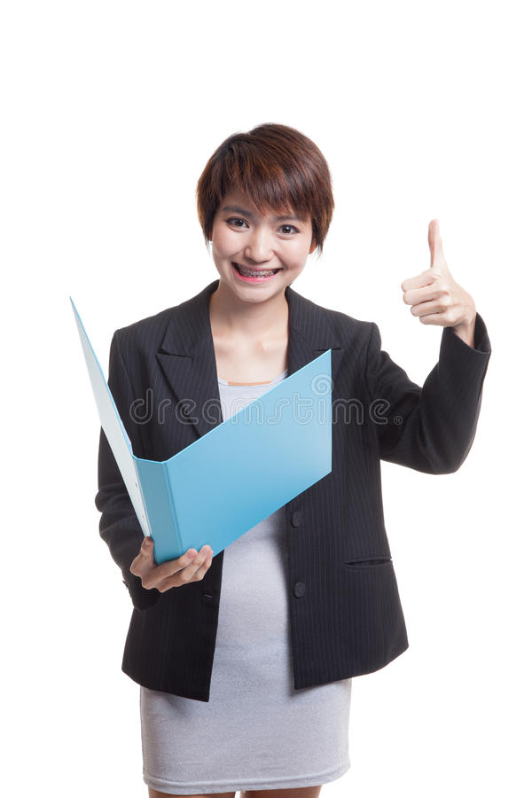 Young Asian working woman thumbs up with folder. Young Asian working woman thumbs up with folder isolated on white background stock image