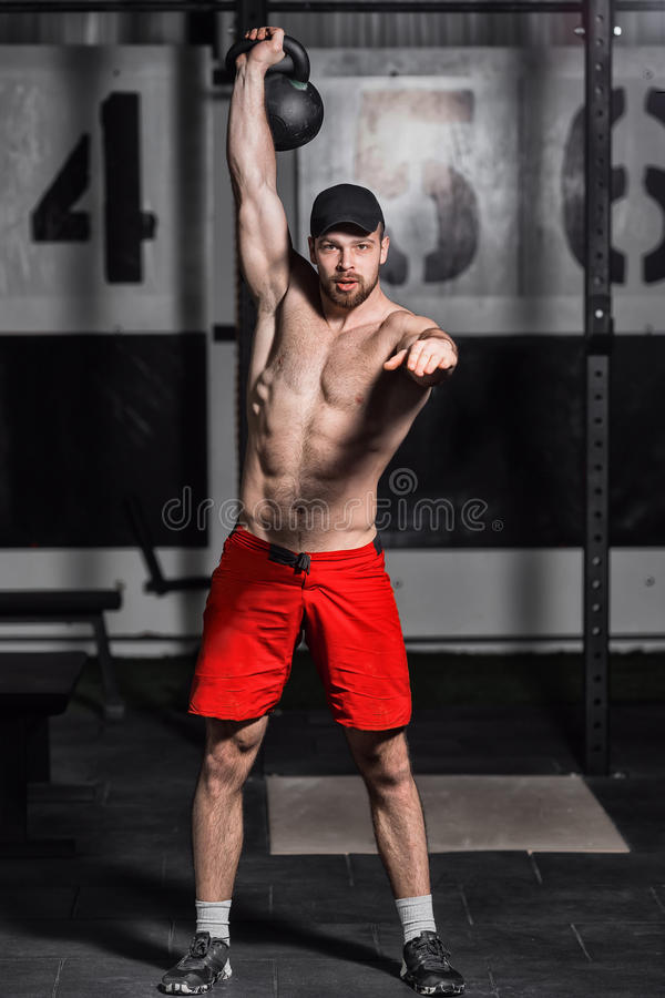 Young athlete doing dumbbell swings. royalty free stock photo