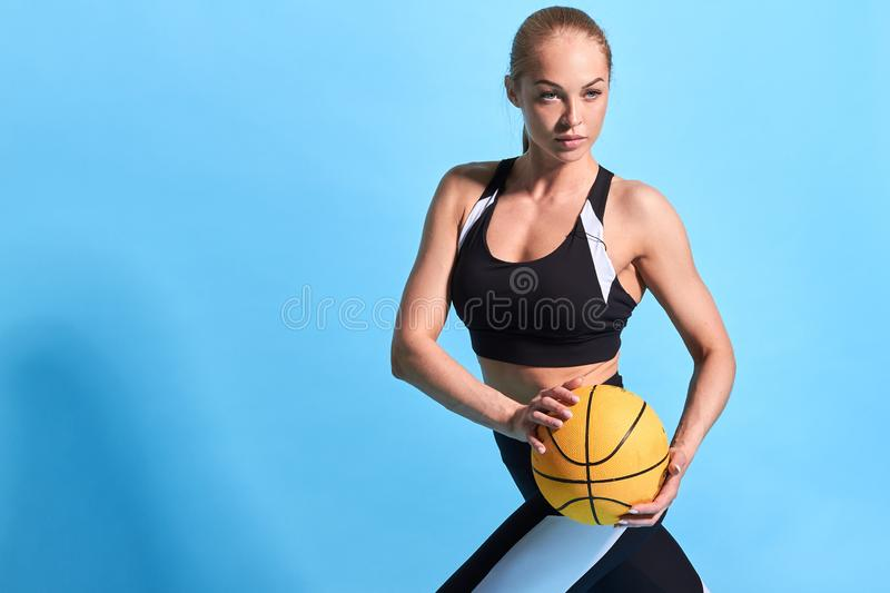 Young athlete doing warming up exercises with a ball royalty free stock image