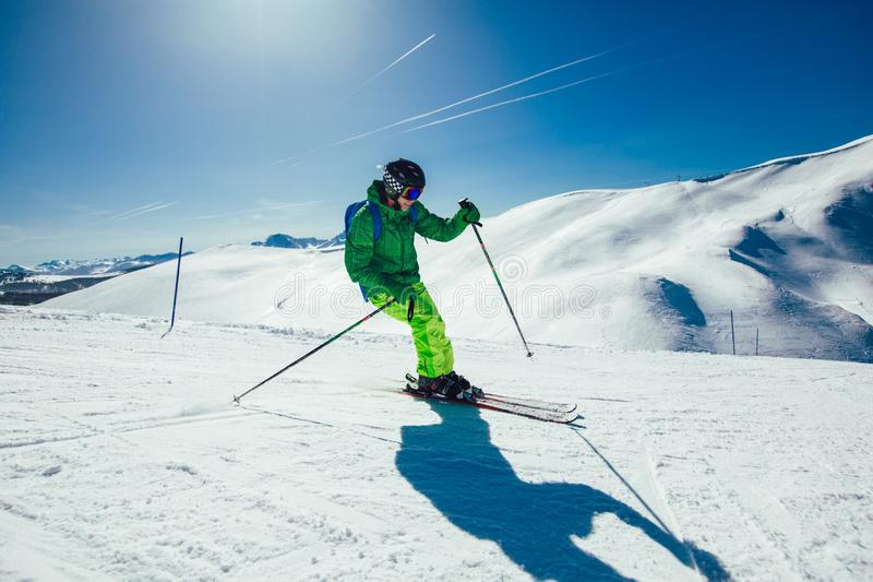 Skier skiing downhill during sunny day stock photography