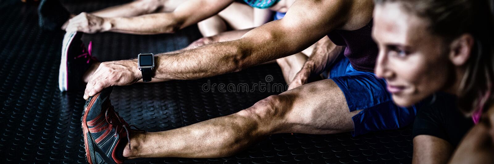 Young athlete friends stretching royalty free stock images
