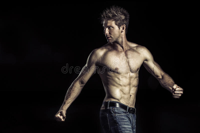 Young athlete showing his body stock photos