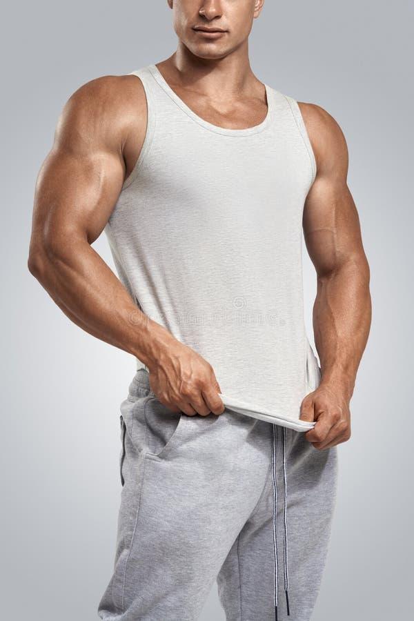Free Young Athlete Wearing Blank White Vest, Sleeveless T-shirt Stock Image - 58785371
