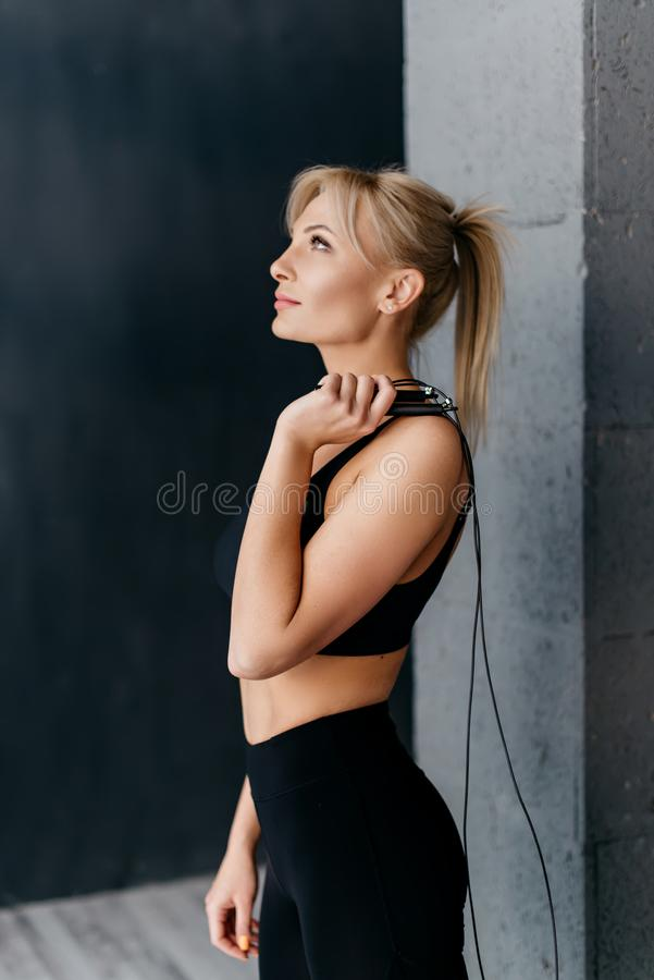 Portrait of sports woman with skipping rope on his shoulder stock photos