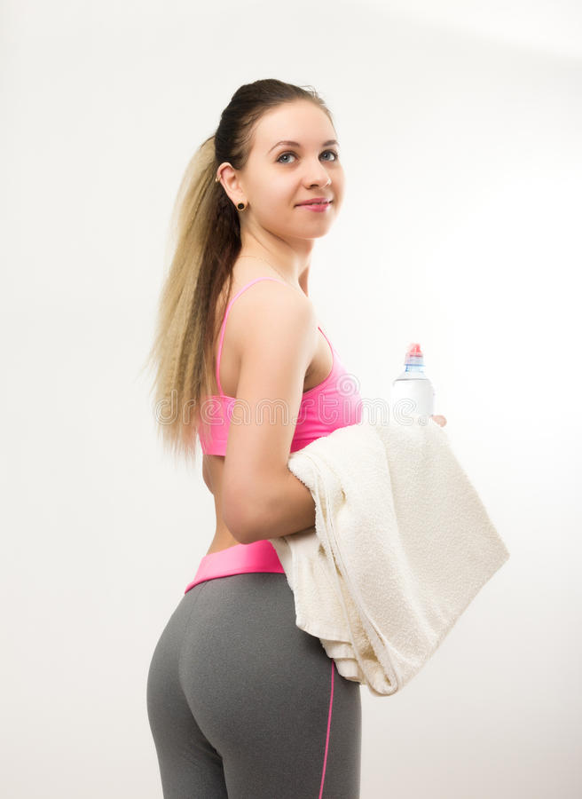 Young athletic girl finished training, holding a royalty free stock photography