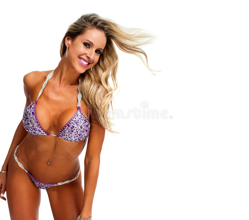 Young athletic girl with body in bikini. royalty free stock images