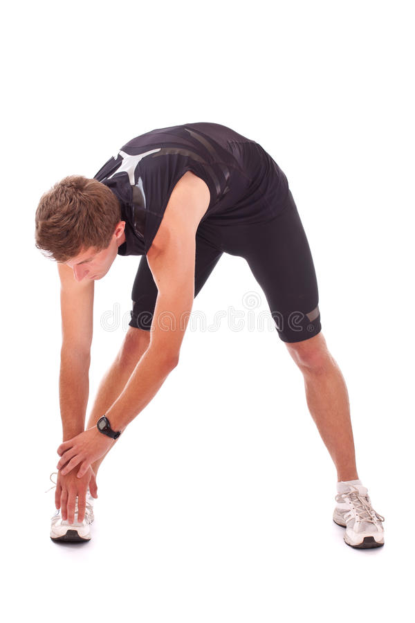 Young athletic man. Making stretching exercises after run isolated on white background royalty free stock images