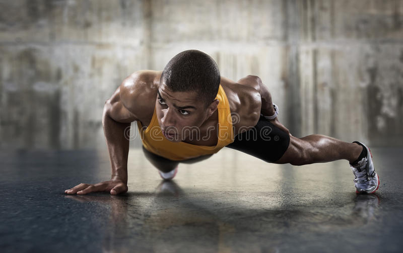 Young athletic man doing push-ups. Sport. Young athletic man doing push-ups. Muscular and strong guy exercising stock photography