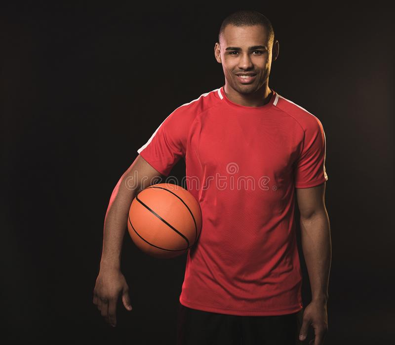 Young athletic man in red t-shirt royalty free stock photography