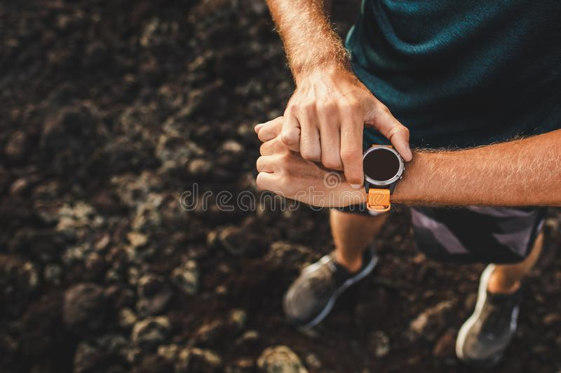 Athletic man using fitness tracker or smart watch stock image