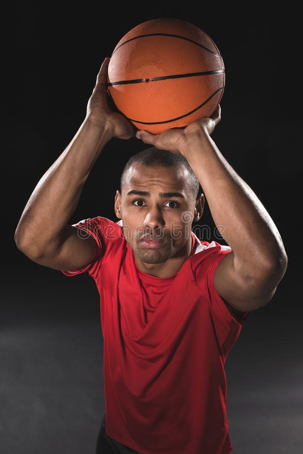 Young athletic man wanting to cast basketball royalty free stock images