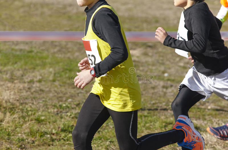 Young athletic runners on a race. Outdoor circuit. Horizontal royalty free stock photos