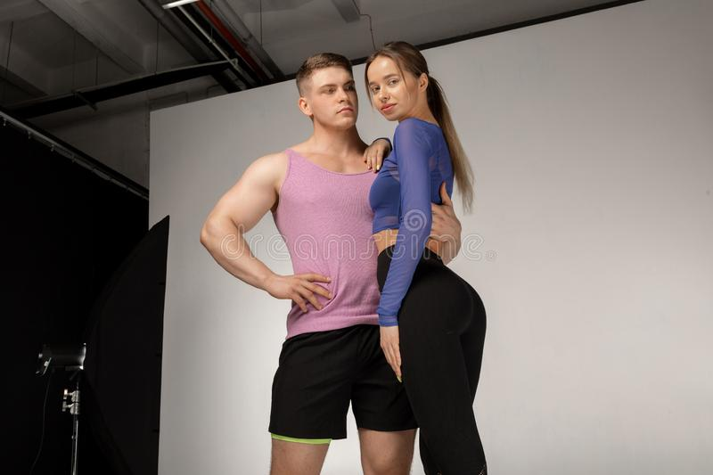 Young athletic shirtless man and beautiful woman in black sportswear royalty free stock images
