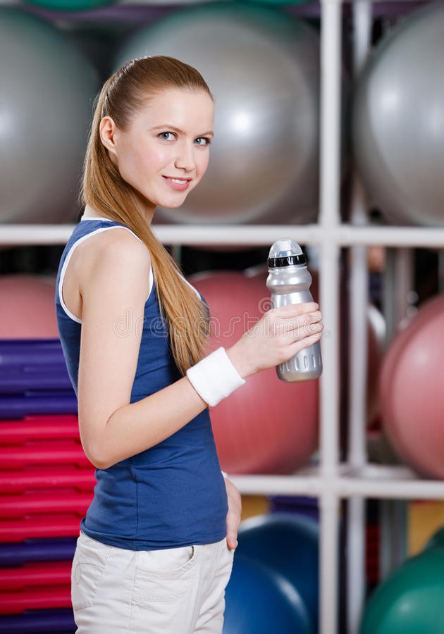Download Young Athletic Woman In Sportswear Holds A Water Bottle Stock Image - Image: 30457379
