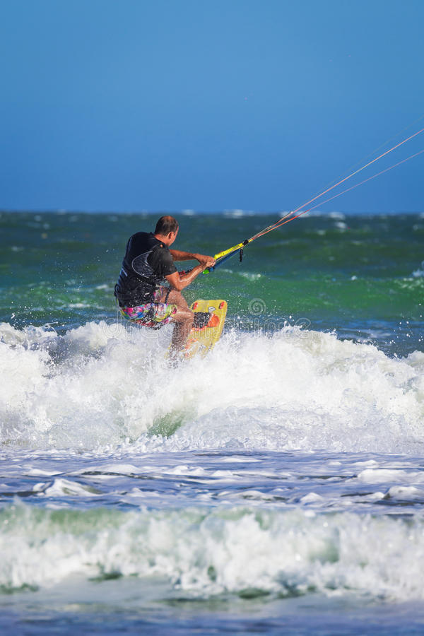 Young atletic man riding kite surf on a sea. In Vietnam stock images