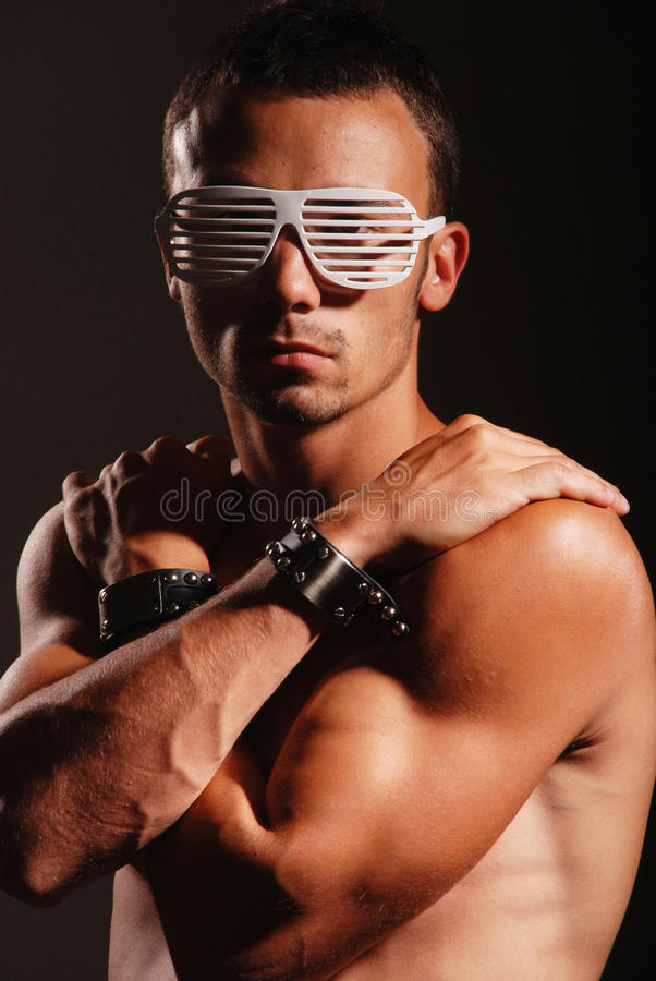 Young atractive man with striped glasses royalty free stock photography