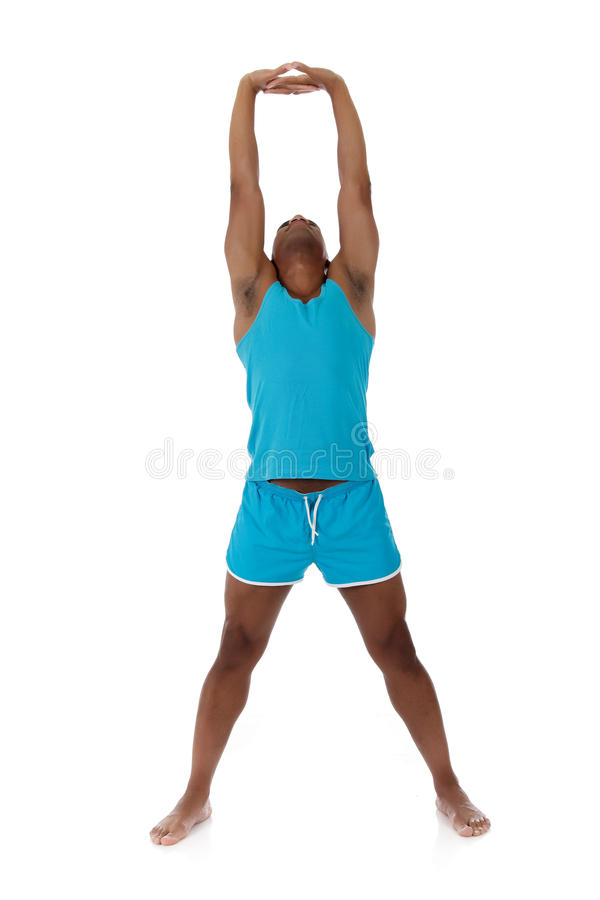 Young attractive African American man athlete. Doing fitness exercises, warming up. White background. Studio shot stock images