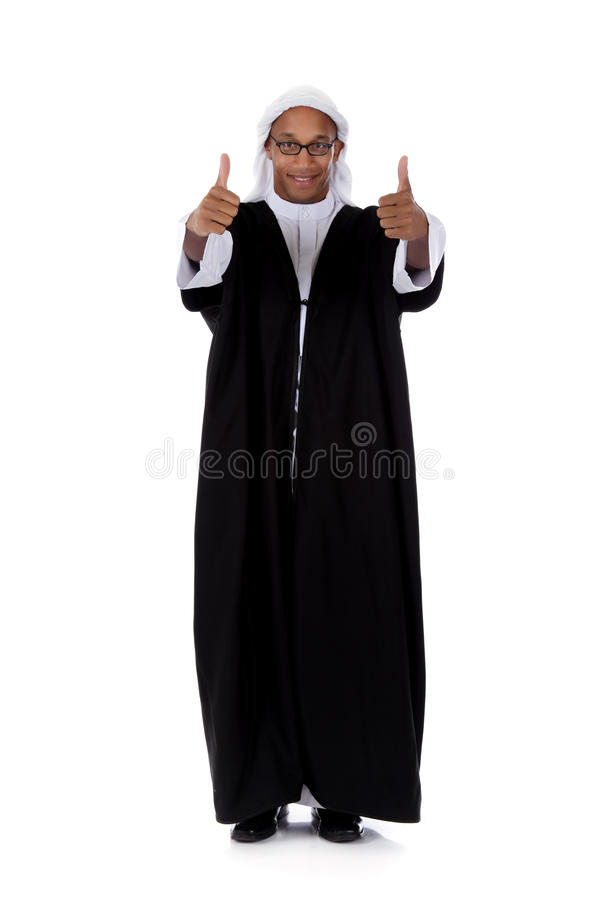 Young attractive African American man, sheikh. Young attractive African American man in sheikh posture dressed in arab garb, thumbs up. Studio shot . White royalty free stock images