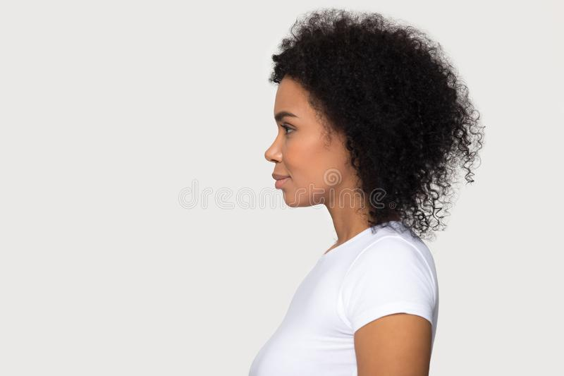 Young attractive African American woman standing in profile isolated stock photography