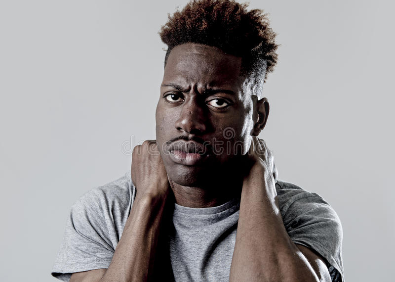 Young attractive afro american black man in sad and tired face expression looking exhausted. Young afro american black man smiling happy taking selfie self royalty free stock photos