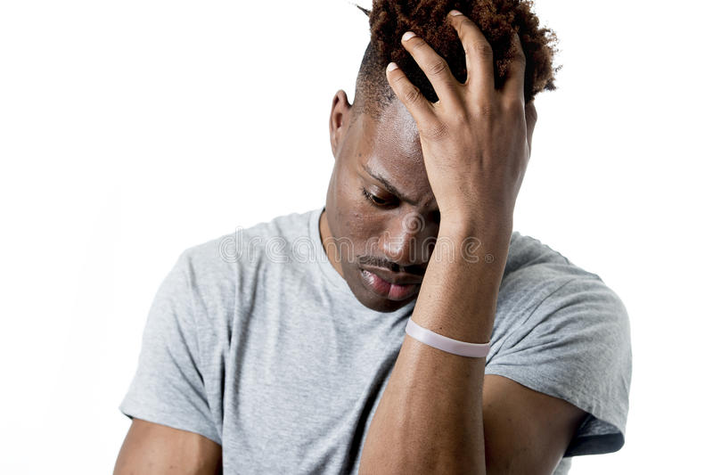 Young attractive afro american man on his 20s looking sad and depressed posing emotional royalty free stock image