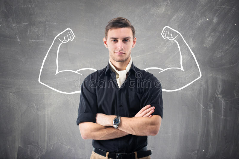 Young attractive ambitious businessman against the royalty free stock photo