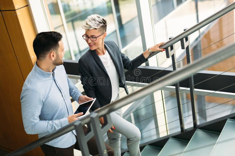 Young architects talking on their way to office royalty free stock images