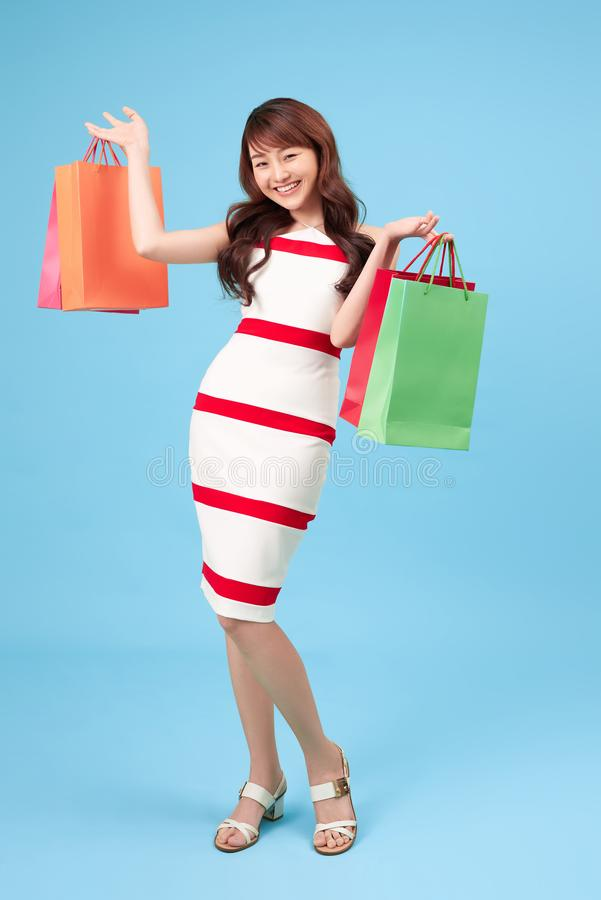 Young attractive asian woman having shopping bags stock images