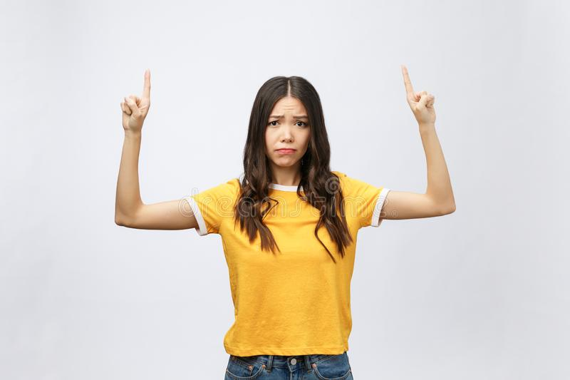 Young attractive asian woman who points to the finger with unhappy emotion. royalty free stock photos