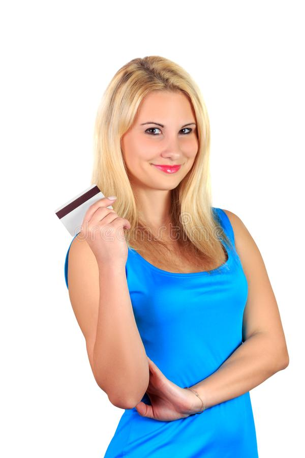 Young attractive beautiful smiling blonde girl in blue dress holds credit card royalty free stock images