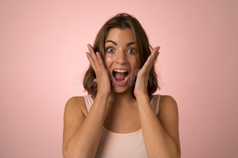 Young attractive and beautiful woman smiling excited and happy in nice shock and surprise showing positive face royalty free stock photography