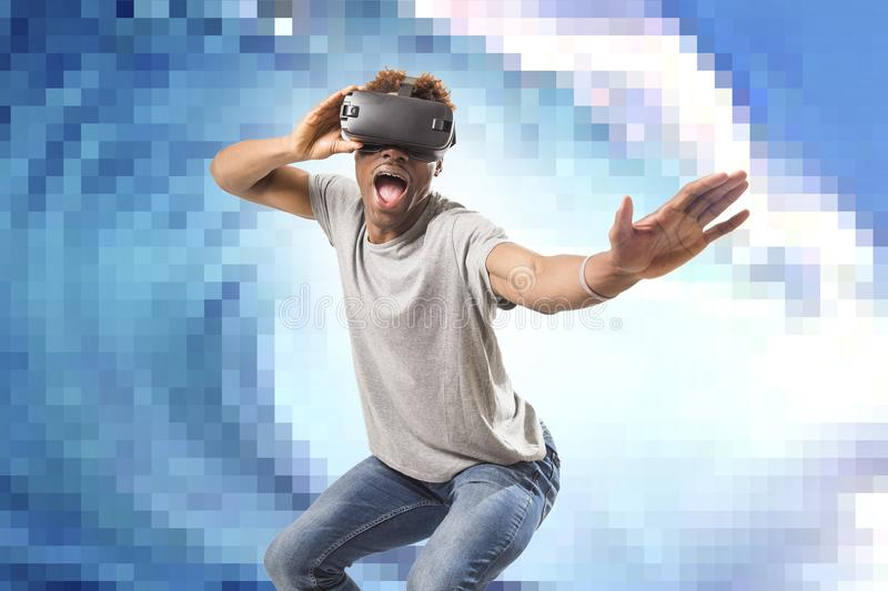 Young attractive black afro American man using vr virtual reality 3D goggles playing surf videogame with pixelated computer sea wa stock photos
