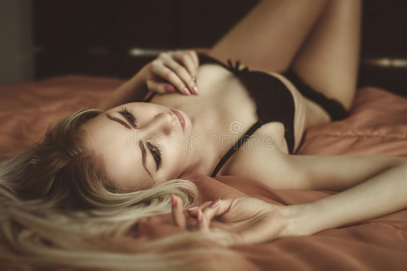 Download Young Attractive  Blond Woman In Lingerie Posing In Bed. Vo Royalty Free Stock Image - Image: 38123836