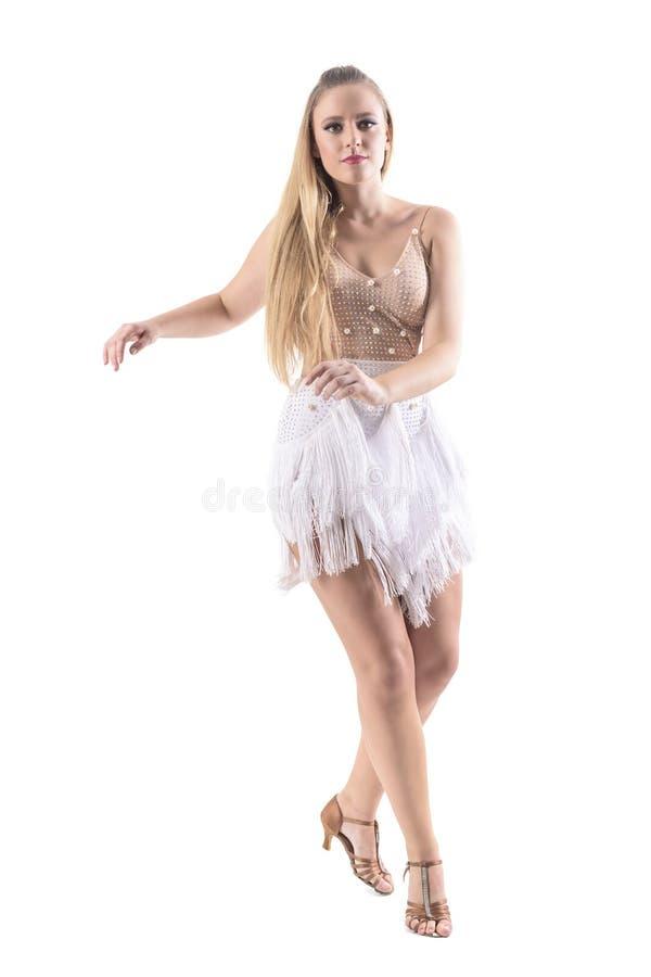 Young attractive blonde caucasian woman dancing latino dances looking at camera. stock photo
