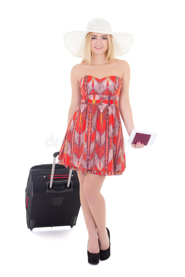 Young attractive blondie woman in red dress with suitcase, passport and ticket isolated on white. Background royalty free stock photos
