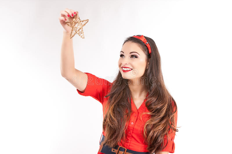 Young attractive brunette woman holding christmas star. royalty free stock photos