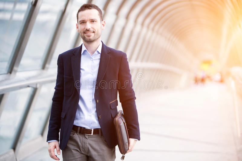 Young attractive business man in business district royalty free stock photos
