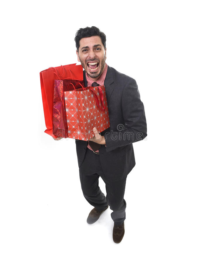Young attractive business man in stress holding lot of shopping bags looking tired bored and worried. After expending too much money on gifts and presents royalty free stock images