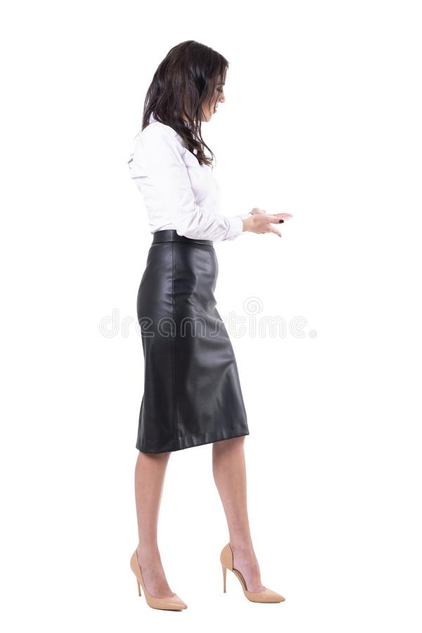 Young attractive business woman assisting with welcome or invite hand gesture. stock image