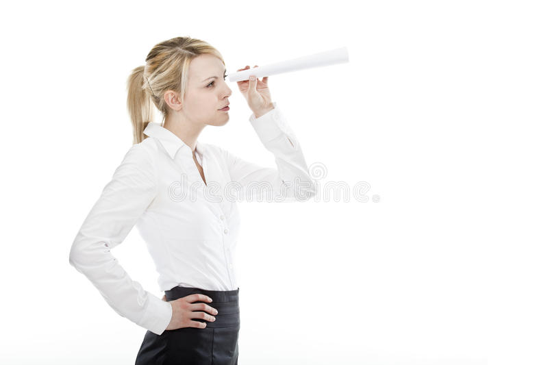 Young attractive business woman holding spyglass stock photo