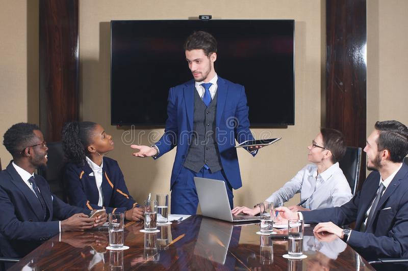 Portrait of Smart Business Partners Using Laptop at Meeting. stock images