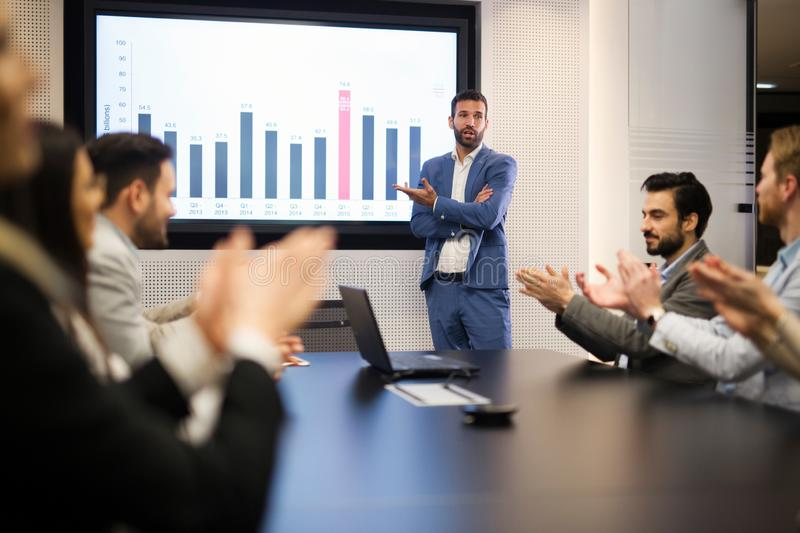 Young attractive businessman showing presentation to his colleagues stock images