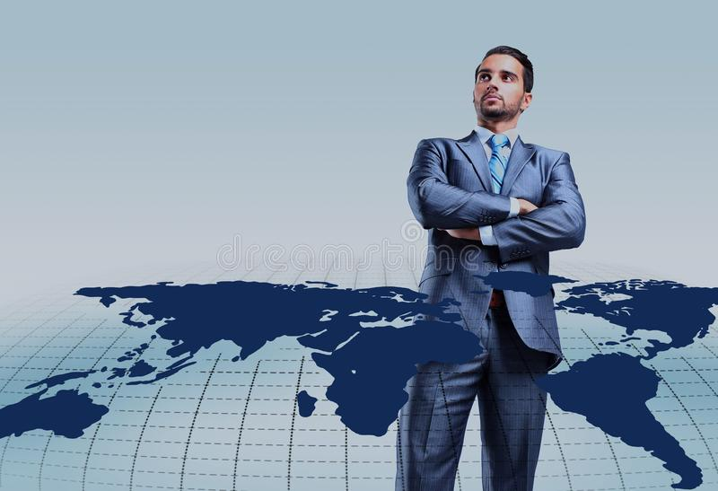 Young businessman with world map. Young attractive businessman with world map royalty free stock images