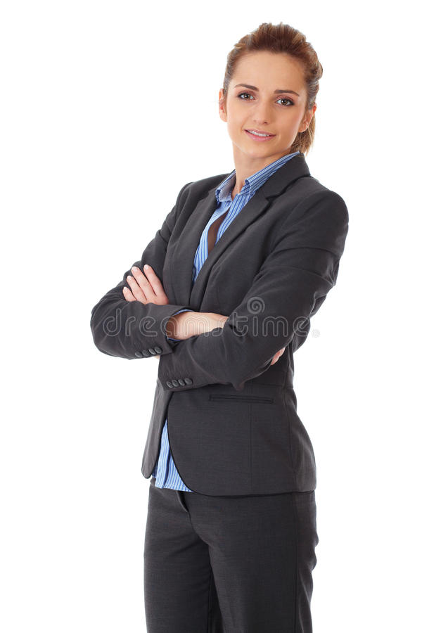 Young attractive businesswoman with crossed arms royalty free stock photography